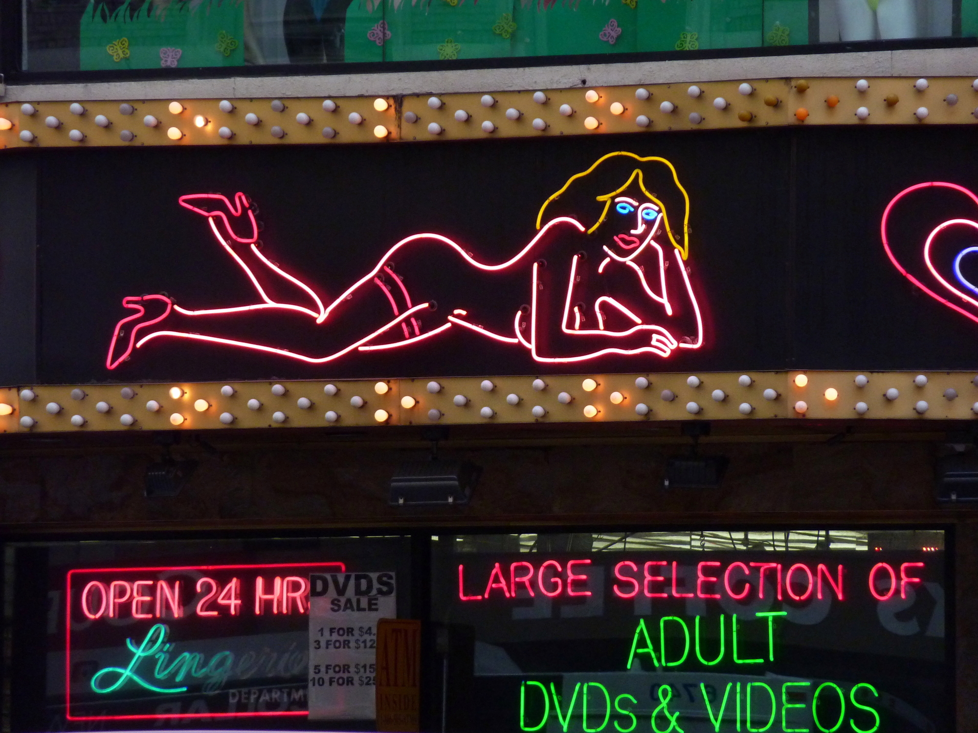 Neon signs of sexshop in a red light district of a town.