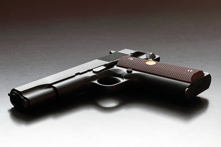 Legendary US .45 caliber 1911 handgun. Classic model. Studio shot.