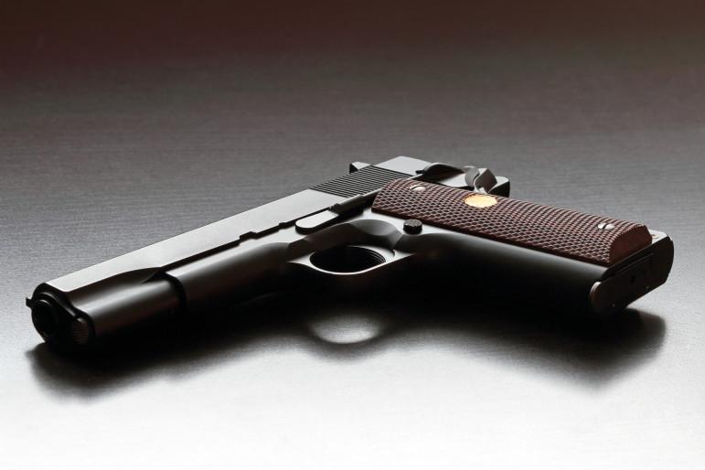 Legendary US .45 caliber 1911 handgun. Classic model. Studio shot.